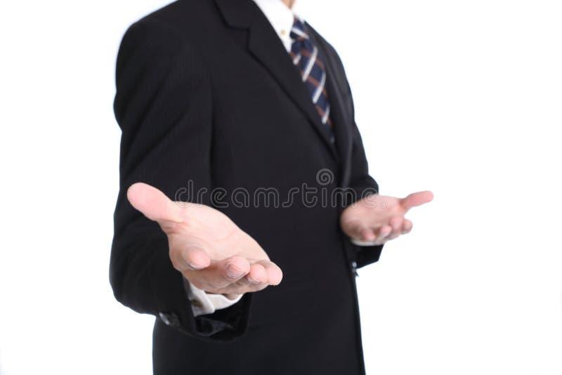 La mano vuota di uso dell'uomo d'affari per il vostro aggiunge qualcosa per la manifestazione fotografia stock libera da diritti