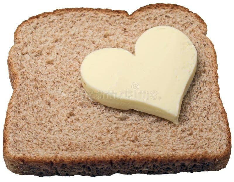 La mantequilla quiere el pan. foto de archivo