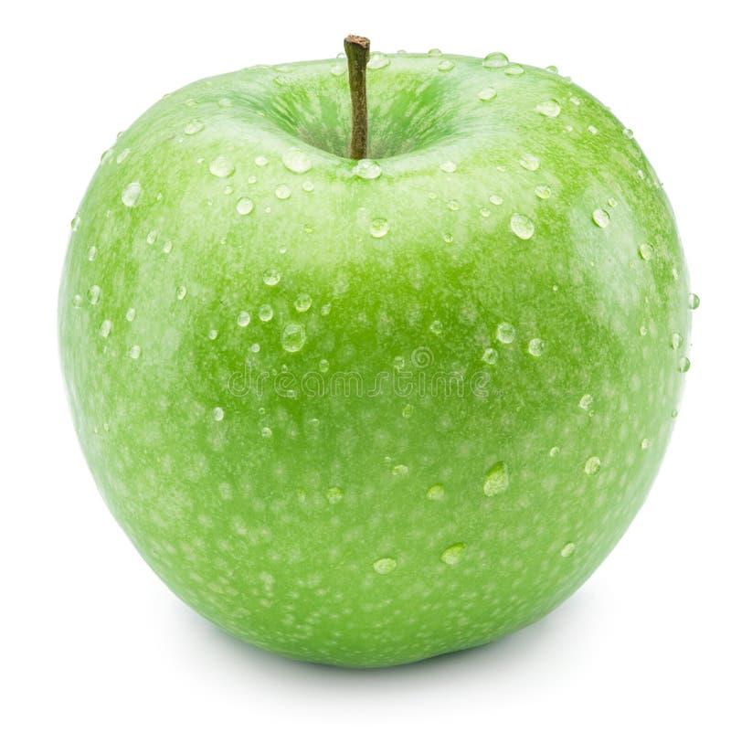 La manzana verde madura con agua cae en ella imagen de archivo