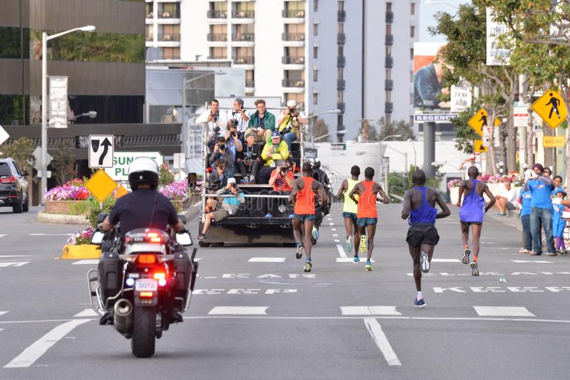LA Marathon - March 15, 2015. Sunset Blvd. Mens Elite running on the Sunset Strip with police escort and photographers tracking them stock photography
