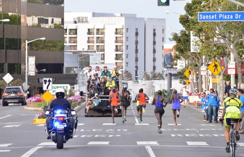 LA Marathon - March 15, 2015. Sunset Blvd. Mens Elite running on the Sunset Strip with police escort and photographers tracking them stock image