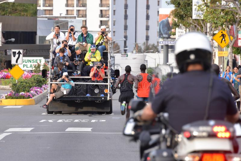 LA Marathon - March 15, 2015. Sunset Blvd. Mens Elite running on the Sunset Strip with police escort and photographers tracking them stock photo