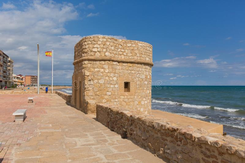 La mata Spain historic 14th century watch tower on the seafront. Torre del Embarcadero historic 14th century watch tower on La Mata promenade royalty free stock image