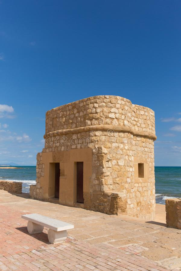 La mata Spain historic 14th century watch tower on the seafront. Torre del Embarcadero historic 14th century watch tower on La Mata promenade stock photos