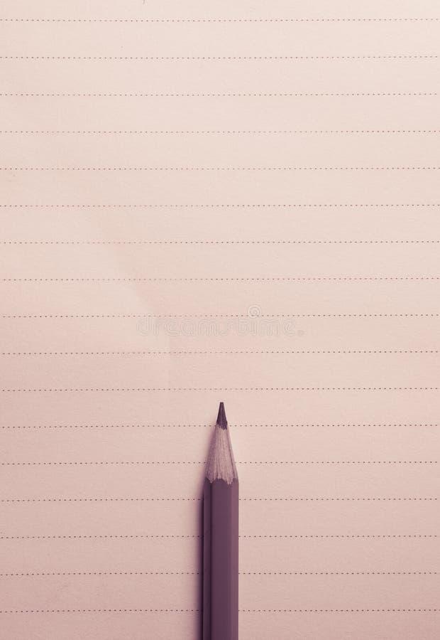 la matita minima sul taccuino allinea il fondo con la vista di spcae della copia fotografia stock libera da diritti