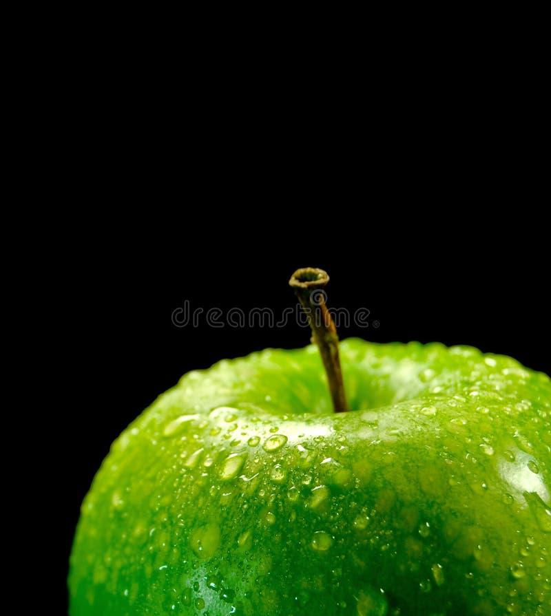 La mela verde sugosa. immagine stock