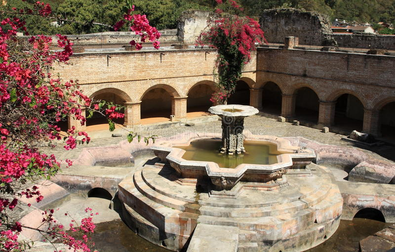 La Merced monastery and convent, Antigua Guatemala. Fountain inside the ruins of the La Merced convent and monastery in Antigua, Guatemala. The monastery was royalty free stock images