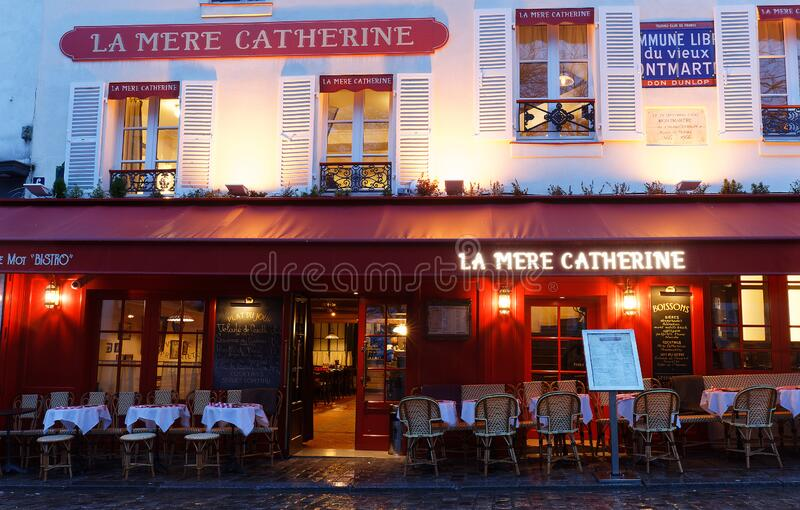 La Mere Catherine at rainy morning . It is a traditional French restaurant in the Montmartre district, Paris, France royalty free stock photo