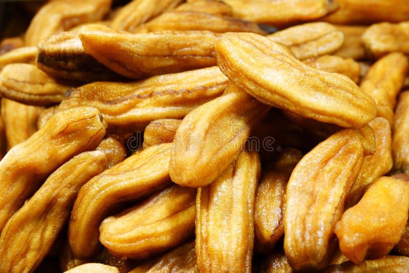 La miel secada de los plátanos coció la comida preservada tailandesa de los plátanos imagenes de archivo