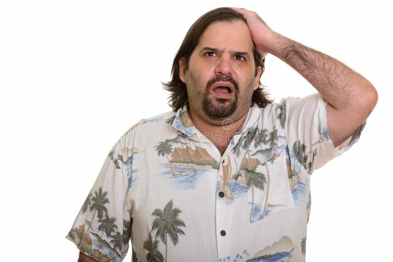 La mirada caucásica gorda del hombre subrayó listo para las vacaciones fotos de archivo