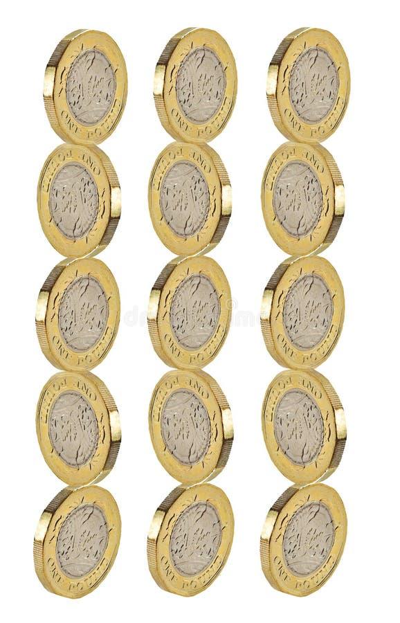 La moneda de libra del oro apila efectivo del dinero de las pilas imagen de archivo libre de regalías
