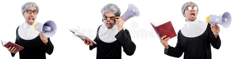 La monja de sexo masculino divertida con el megáfono aislado en blanco imágenes de archivo libres de regalías