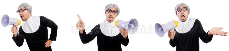 La monja de sexo masculino divertida con el megáfono aislado en blanco imagen de archivo libre de regalías