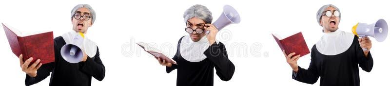 La monja de sexo masculino divertida con el meg?fono aislado en blanco fotos de archivo