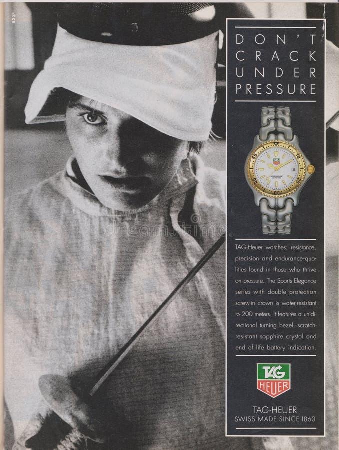 La montre d'étiquette-Heuer de publicité par affichage en magazine à partir de 1992, NE FENDENT PAS SOUS le slogan de PRESSUERE photos stock
