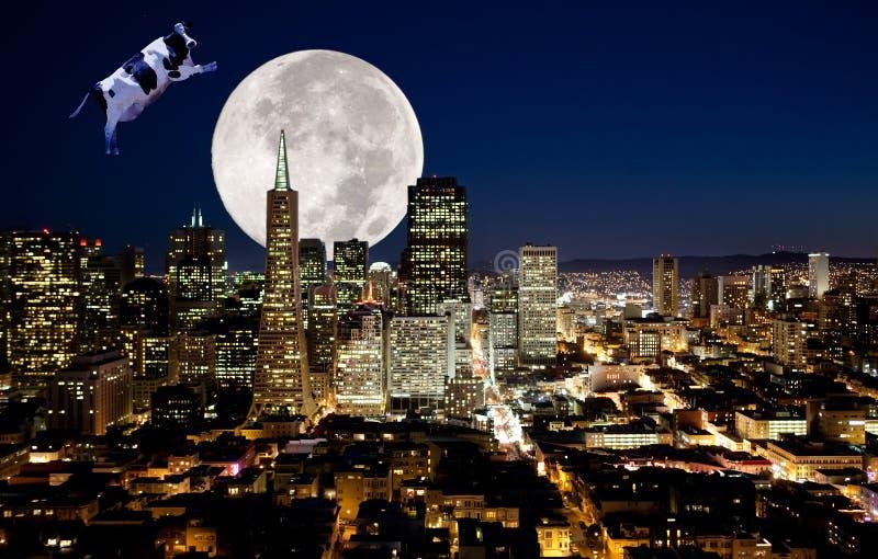 La mucca salta sopra la luna fotografie stock