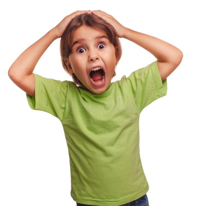 La muchacha adolescente asustó al niño abrió su boca siente miedo fotos de archivo