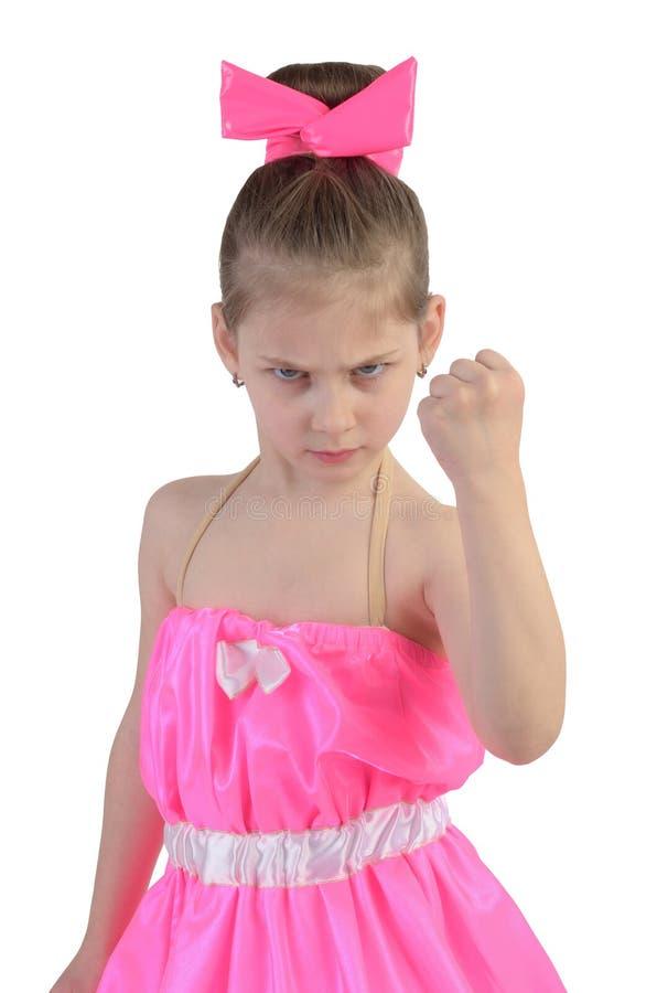 La muchacha amenaza al puño imagenes de archivo