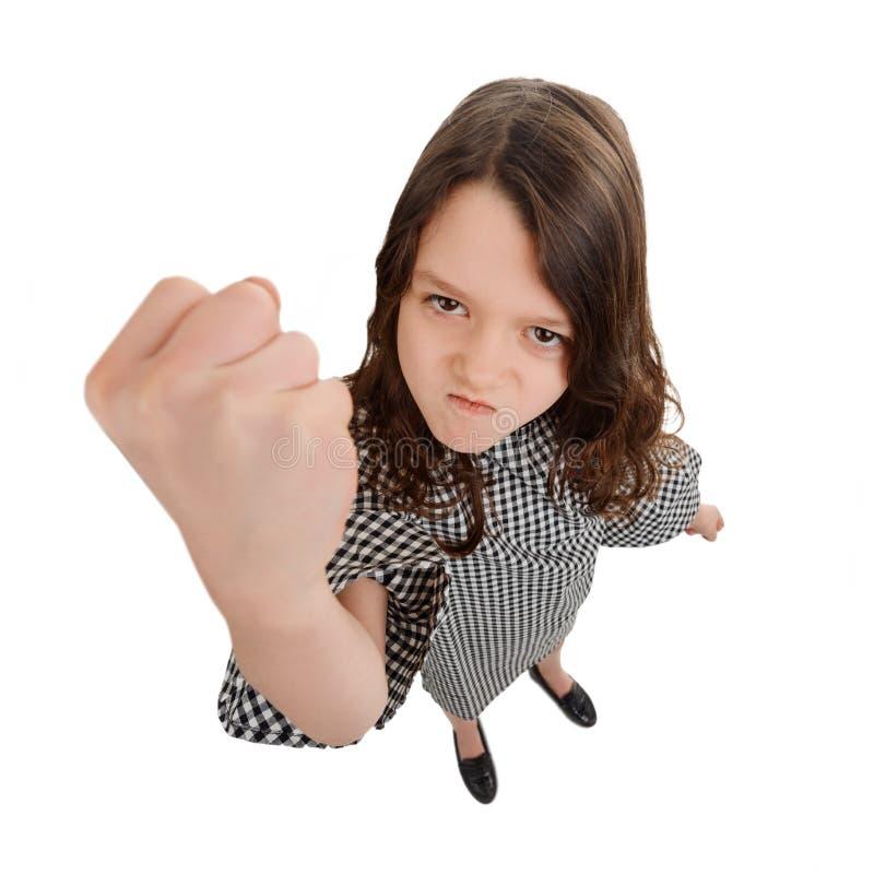 La muchacha amenaza con un sacador fotos de archivo