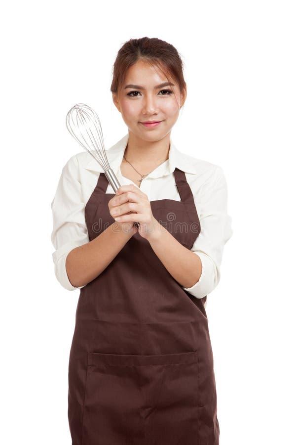 La muchacha asiática del panadero con bate imagenes de archivo