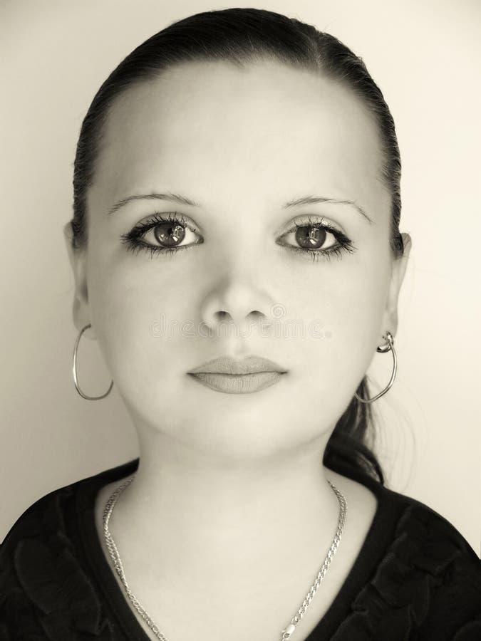 La muchacha con mayores ojos fotografía de archivo