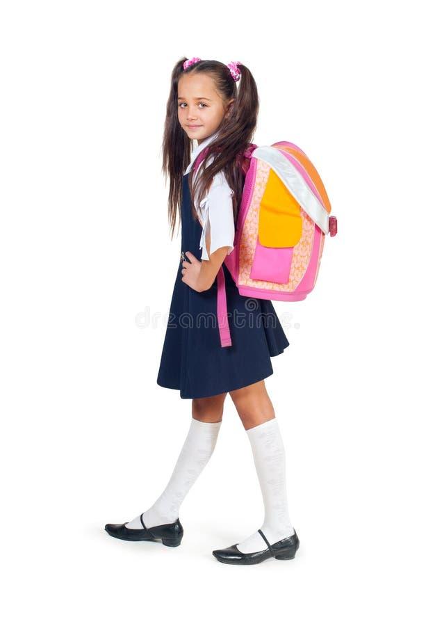 La muchacha con un bolso de escuela imagenes de archivo