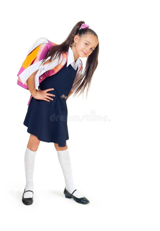 La muchacha con un bolso de escuela imágenes de archivo libres de regalías