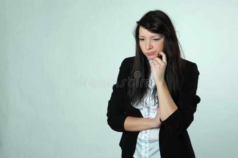 La muchacha con una mímica descontenta imagen de archivo libre de regalías