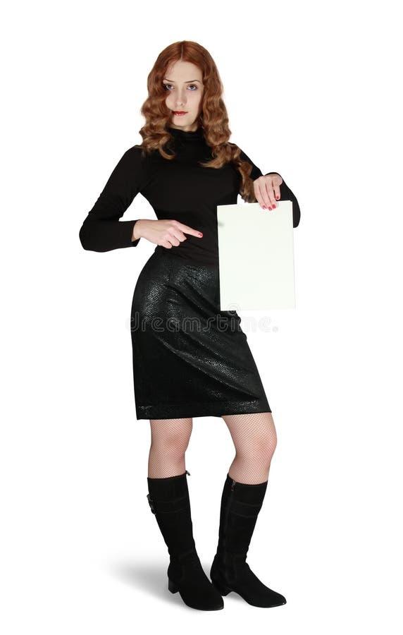 La muchacha de pelo largo sostiene un cartel vacío fotos de archivo libres de regalías