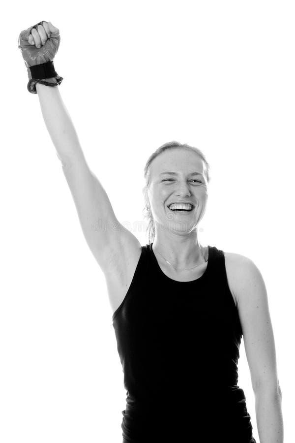 La muchacha del ganador en guantes de boxeo imágenes de archivo libres de regalías
