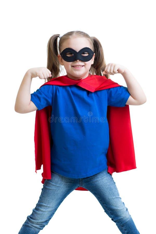 La muchacha del niño juega al super héroe imagen de archivo libre de regalías