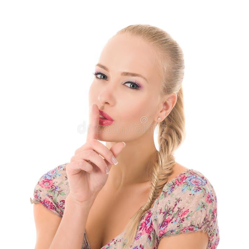 La muchacha dice shhh imagen de archivo libre de regalías