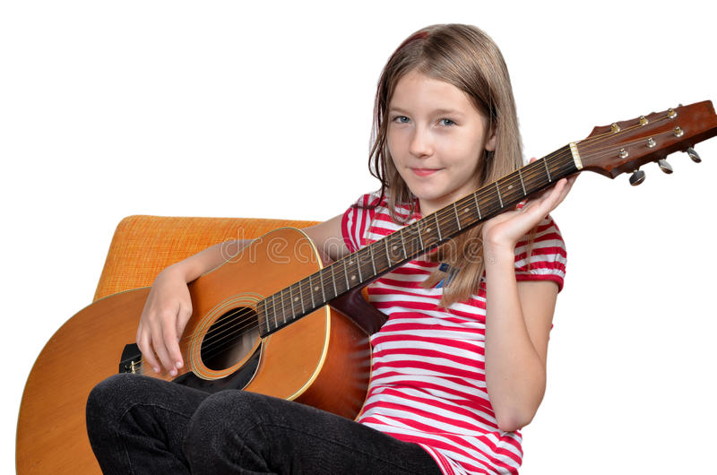 La muchacha divertida tiene gusto de música imágenes de archivo libres de regalías