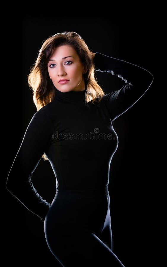 La muchacha en negro fotografía de archivo libre de regalías