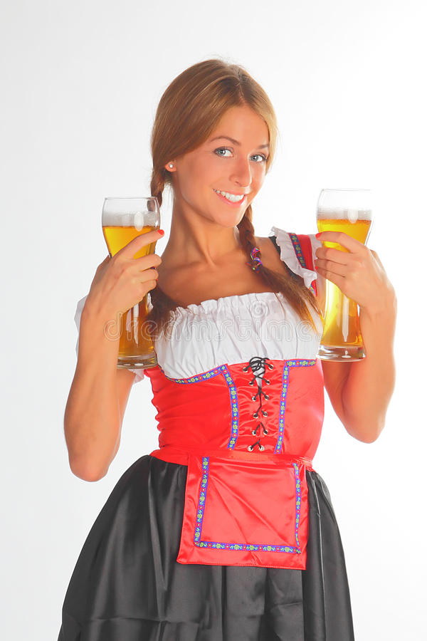 La muchacha en una alineada bávara tradicional fotografía de archivo libre de regalías