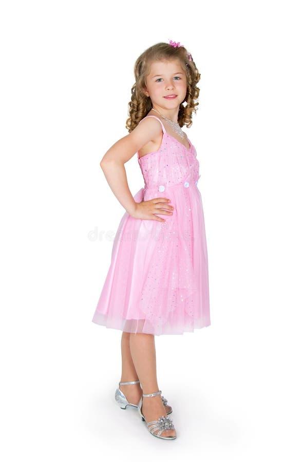 La muchacha en una alineada rosada fotografía de archivo
