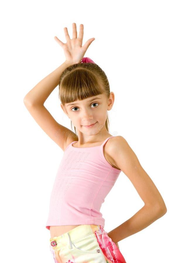 La muchacha en una blusa rosada imagen de archivo