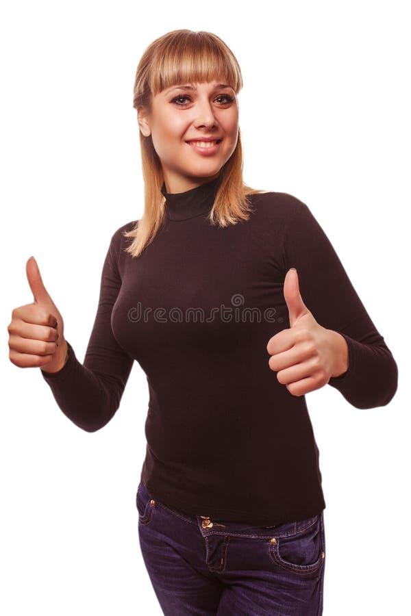 La muchacha feliz de la mujer joven muestra la muestra positiva del estudio fotografía de archivo