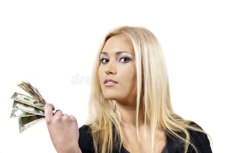 La muchacha guarda el dinero imagenes de archivo