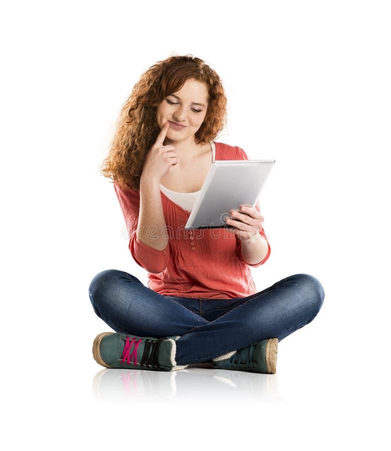 Muchacha con la tableta foto de archivo libre de regalías