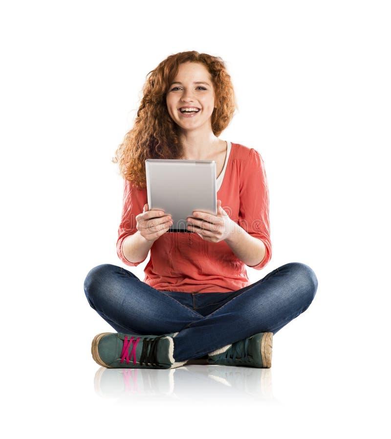 Muchacha con la tableta imagen de archivo libre de regalías