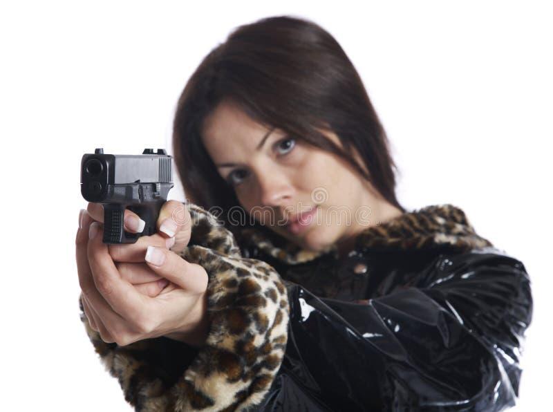 La muchacha hermosa con una pistola fotos de archivo libres de regalías