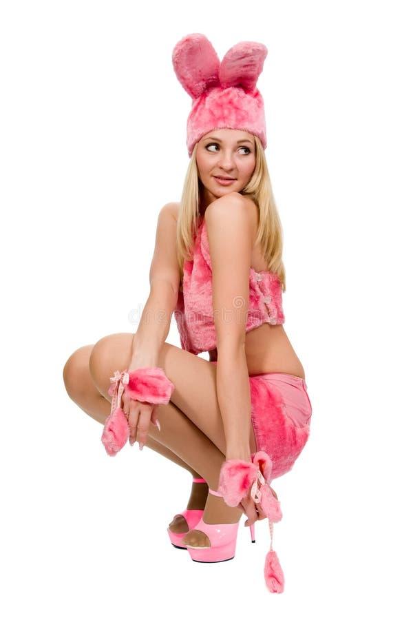 La muchacha hermosa en alineada de lujo rosada. foto de archivo