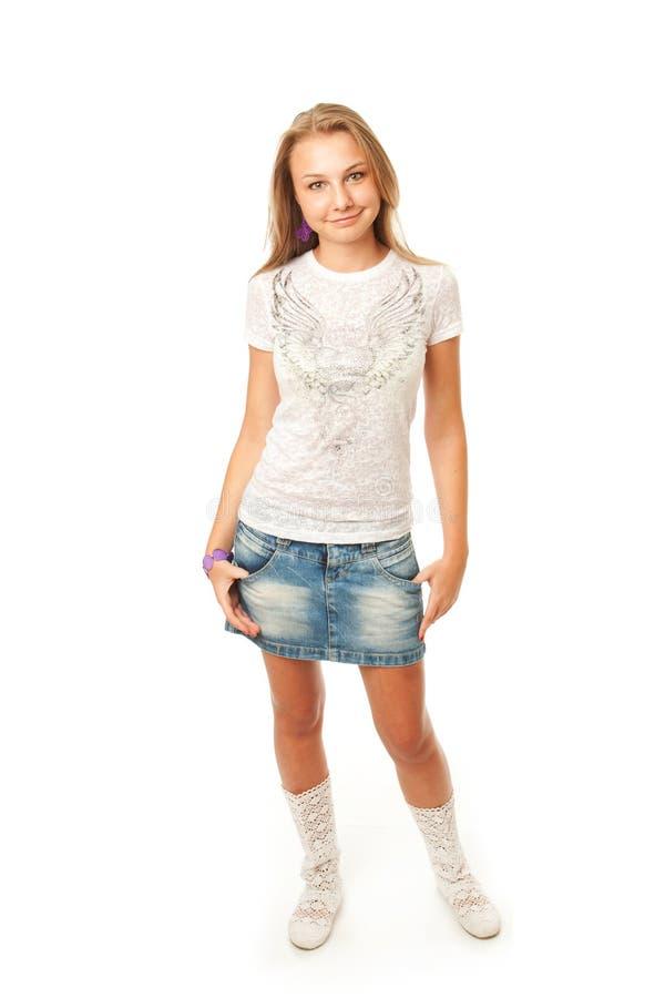 La muchacha hermosa joven aislada en un blanco imagen de archivo