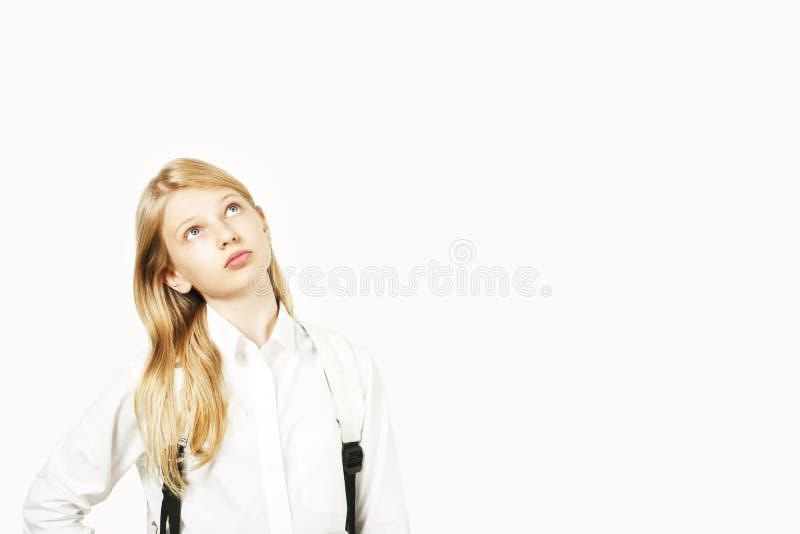 La muchacha hermosa joven del modelo del adolescente que presentaba sobre blanco aisló el fondo que mostraba expresiones faciales fotografía de archivo