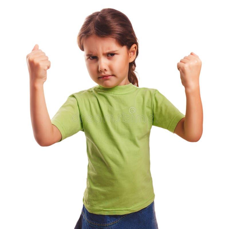 La muchacha malvada enojada muestra los puños que experimenta cólera fotos de archivo