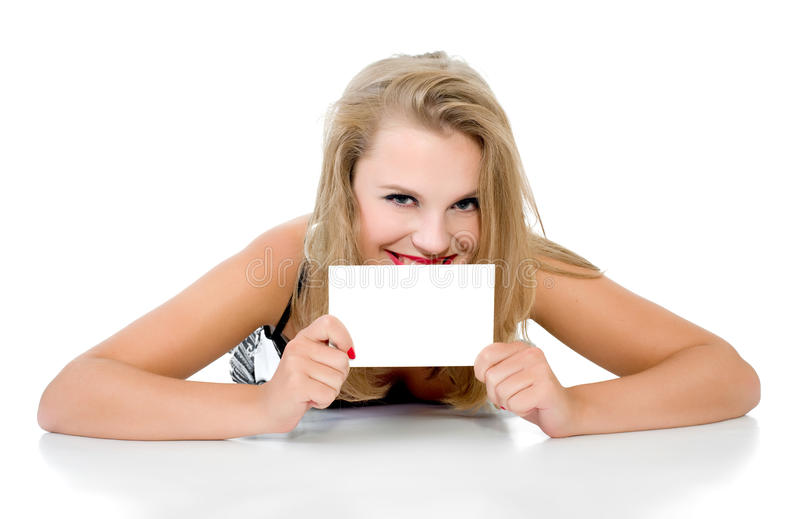 La muchacha miente y sostiene la tablilla aislada imágenes de archivo libres de regalías