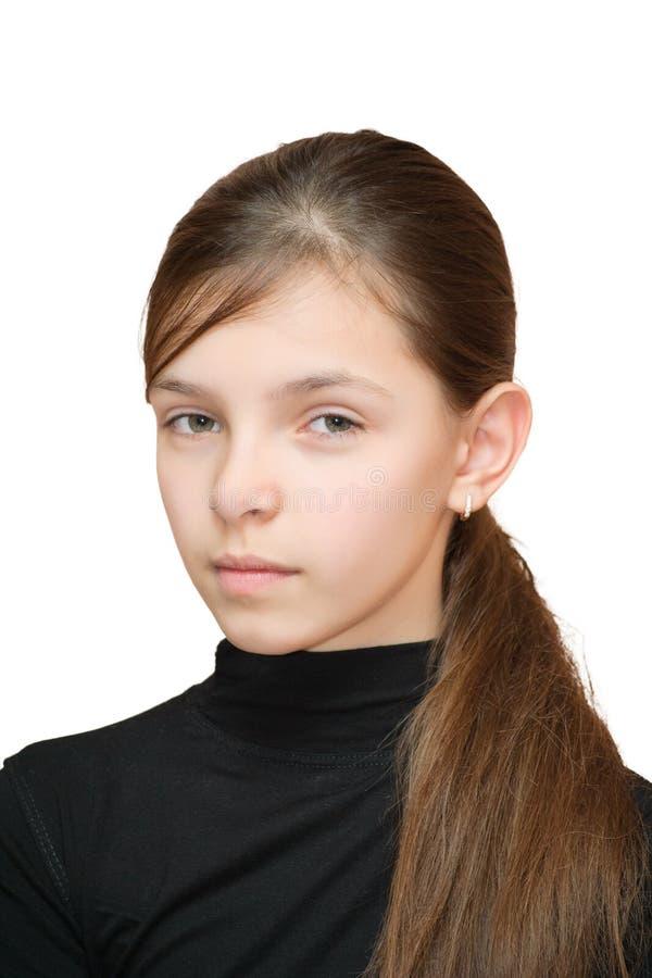 La muchacha mira sospechoso fotografía de archivo