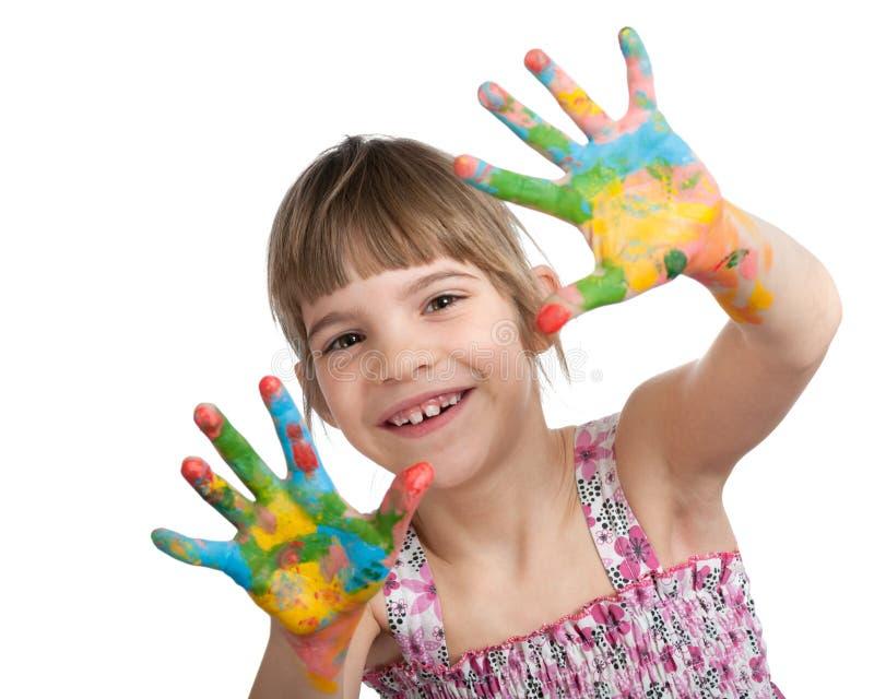 Niña con sus manos pintadas fotografía de archivo