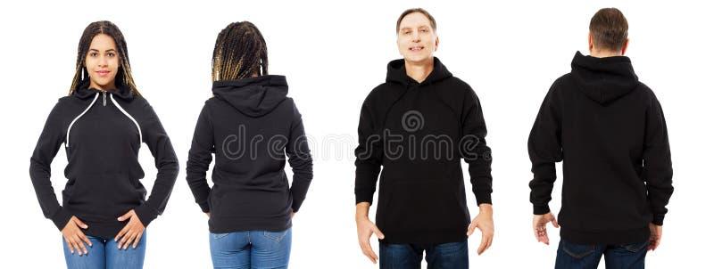 La muchacha negra en maqueta de la sudadera con capucha, el hombre en frente vacío de la capilla y la visión trasera aislados sob imágenes de archivo libres de regalías